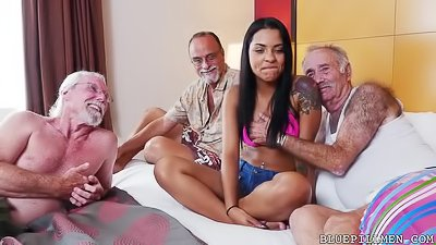 Three older men are fucking brunette